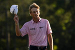 Will Zalatoris tips his cap after putting on the 18th hole during the final round of the Masters golf tournament on Sunday, April 11, 2021, in Augusta, Ga. (AP Photo/David J. Phillip)