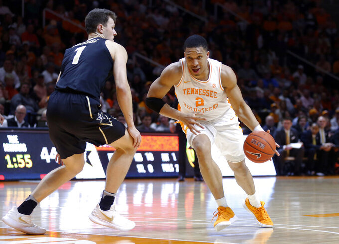Tennessee forward Grant Williams (2) drives past Vanderbilt forward Yanni Wetzell (1) during the second half of an NCAA college basketball game Tuesday, Feb. 19, 2019, in Knoxville, Tenn. Tennessee won 58-46. (AP photo/Wade Payne)