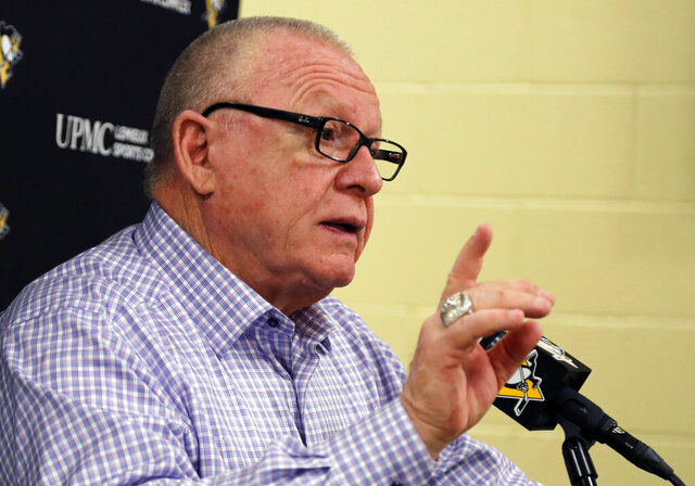 FILE - Pittsburgh Penguins general manager Jim Rutherford has his final meeting of the season with the media at the NHL hockey team's practice facility in Cranberry, Pa., in this Wednesday, May 9, 2018, file photo. Pittsburgh Penguins general manager Jim Rutherford, a Hall of Famer who helped lead to a pair of Stanley Cup titles, resigned abruptly on Wednesday, Jan. 27, 2021. (AP Photo/Gene J. Puskar, File)