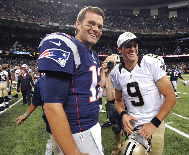FILE - In this Aug. 22, 2015, file photo, New England Patriots quarterback Tom Brady (12) and New Orleans Saints quarterback Drew Brees (9) greet each other after an NFL preseason football game in New Orleans. Between them, Brady and Brees have played 38 pro football seasons, 39 if you count 2008 when the New England star wrecked his knee in Week 1,  and could be doing so against each other on Feb. 2 in a little thing called the Super Bowl. (AP Photo/Bill Feig. File)