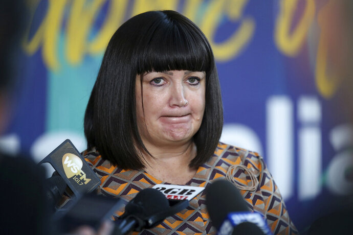 Rugby Australia Chief Executive, Raelene Castle announces that Rugby Australia has terminated star fullback Israel Folau's contract in Sydney, Australia, Friday, May 17, 2019. Rugby Australia terminated Folau's contract after he was found guilty of a high-level breach of the players' code of conduct for a social media post that condemned gay people and other
