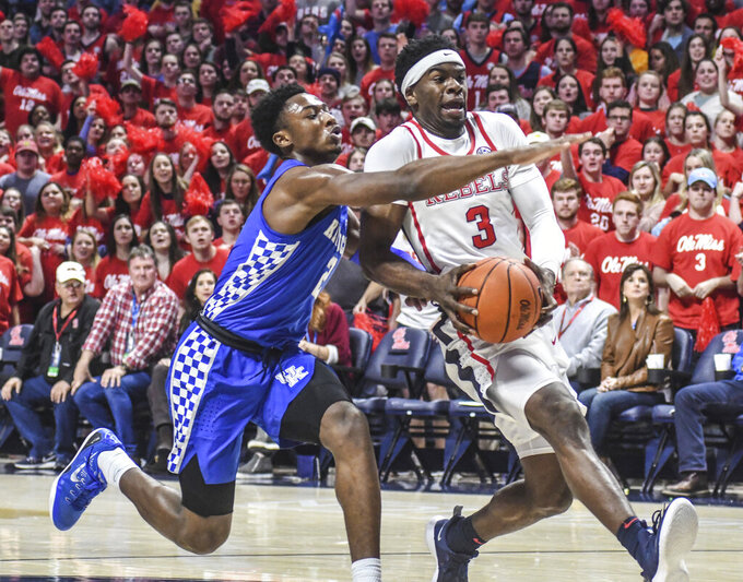 Mississippi guard Terence Davis (3) is defended by Kentucky guard Ashton Hagans (2) during an NCAA college basketball game in Oxford, Miss., Tuesday, March 5, 2019. (Bruce Newman/The Oxford Eagle via AP)