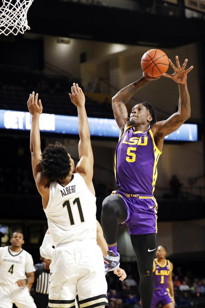 LSU forward Emmitt Williams (5) drives against Vanderbilt's Braelee Albert (11) in the first half of an NCAA college basketball game Wednesday, Feb. 5, 2020, in Nashville, Tenn. (AP Photo/Mark Humphrey)