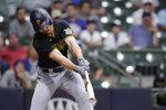 Pittsburgh Pirates' Bryan Reynolds hits a two-run single during the 10th inning of the team's baseball game against the Milwaukee Brewers on Tuesday, Aug. 3, 2021, in Milwaukee. (AP Photo/Aaron Gash)