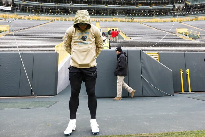 Carolina Panthers' Christian McCaffrey pauses at Lambeau Field before an NFL football game against the Green Bay Packers Sunday, Nov. 10, 2019, in Green Bay, Wis. (AP Photo/Jeffrey Phelps)