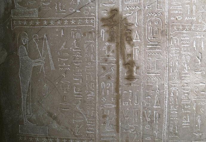 File--File picture taken Oct.21, 2020 a stain is on Sarcophagus of the prophet Ahmose inside the Egyptian Court of the Neue Museum after smeared with a liquid in Berlin, Germany. A large number of art works and artifacts at some of Berlin's best-known museums were smeared with a liquid by an unknown perpetrator or perpetrators earlier this month, police said Wednesday. The 'numerous' works in several museums at the Museum Island complex, a UNESCO world heritage site in the heart of the German capital that is one of the city's main tourist attractions, were targeted between on Oct. 3, police said. (AP Photo/Markus Schreiber, file)
