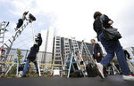 TV crews and photographers and cameramen set up their ladders in front of Tokyo Detention Center, where former Nissan Chairman Carlos Ghosn is detained, Thursday, April 25, 2019, in Tokyo. Detained former Nissan chairman Ghosn paid 500 million yen ($4.5 million) in bail, the Tokyo District court said Thursday, signaling he would likely soon be released. (AP Photo/Eugene Hoshiko)