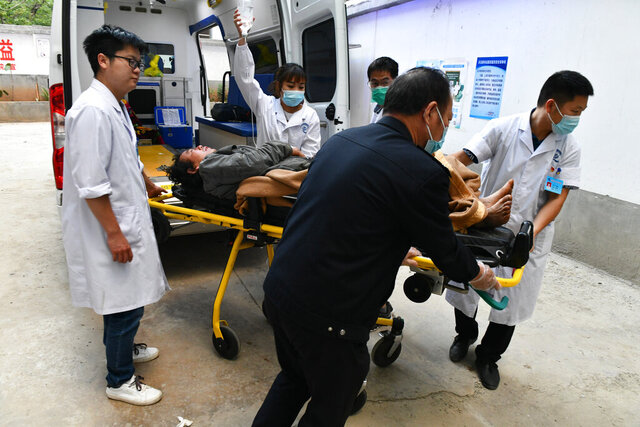 In this photo released by Xinhua News Agency, medical staff transfer an injured person after an earthquake in Qiaojia County of Zhaotong, southwest China's Yunnan Province, Tuesday, May 19, 2020. The earthquake in southwestern China has killed some and injured others, according to the China Earthquake Networks Center. The temblor in Yunnan province's Qiaojia county struck at 9:47 p.m. Monday at a relatively shallow depth of 8 kilometers (5 miles). (Chen Xinbo/Xinhua via AP)