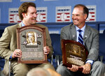 FILE - In this July 31, 2005, file photo, National Baseball Hall of Fame inductees Wade Boggs, left, and Ryne Sandberg talk after being inducted at the Clark Sports Center in Cooperstown, N.Y. (Heather Ainsworth/Observer-Dispatch via AP, File)