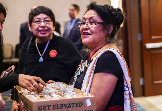 """This photo provided by Mia Boccella shows Aleta """"Tweety"""" Suazo handing out baked goods at a reception held for New Mexico Democratic Congresswoman Deb Haaland on Jan. 3, 2019, in Washington, D.C. Suazo will be among Native Americans closely watching a confirmation hearing for Haaland, who has been nominated to lead the U.S. Department of the Interior, on Tuesday, Feb. 23, 2021. (AP Photo via Mia Boccella)"""