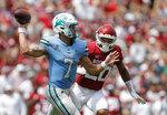 Tulane quarterback Michael Pratt (7) throws a pass as Oklahoma linebacker Clayton Smith (20) closes in during an NCAA college football game Saturday, Sept. 4, 2021, in Norman, Okla. (AP Photo/Alonzo Adams)