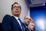 From left, Treasury Secretary Steven Mnuchin, OMB Budget Director Russell Vought, and Scott Atlas, senior fellow at the Hoover Institution, listens as President Donald Trump speaks at a news conference in the James Brady Press Briefing Room at the White House, Monday, Aug. 10, 2020, in Washington. (AP Photo/Andrew Harnik)