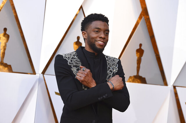 FILE - In this March 4, 2018 file photo, Chadwick Boseman arrives at the Oscars at the Dolby Theatre in Los Angeles.   Actor Chadwick Boseman, who played Black icons Jackie Robinson and James Brown before finding fame as the regal Black Panther in the Marvel cinematic universe, has died of cancer. His representative says Boseman died Friday, Aug. 28, 2020 in Los Angeles after a four-year battle with colon cancer. He was 43.  (Photo by Jordan Strauss/Invision/AP, File)