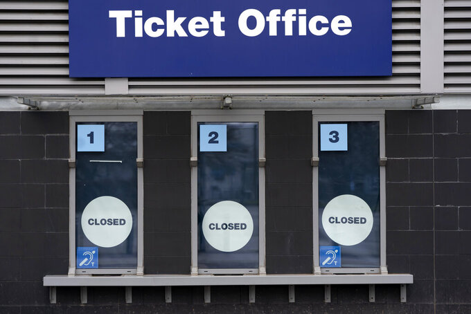 FILE - In this March 14, 2020, file photo, a closed ticket office is shown at Etihad Stadium where Manchester City were due to play Burnley in an English Premier League soccer match, in Manchester, England. Many professional sports league, such as the NFL and European soccer leagues, have lucrative television contracts and big-money corporate sponsors that fill their substantial coffers. But the domestic soccer league in the U.S. still relies heavily on ticket sales, merchandising and concessions, much like many university athletic departments, and without games their very ability to make ends meet would stretch the abilities of even the savviest of accountants. (AP Photo/Jon Super, File)