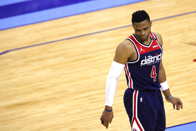Washington Wizards' Russell Westbrook reacts to a call during the fourth quarter of the team's NBA basketball game against the Houston Rockets on Tuesday, Jan. 26, 2021, in Houston. (Carmen Mandato/Pool Photo via AP)
