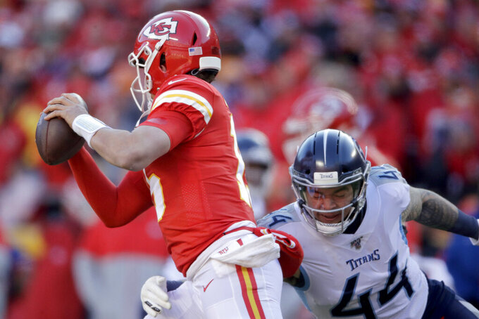 Tennessee Titans' Kamalei Correa (44) sacks Kansas City Chiefs' Patrick Mahomes during the first half of the NFL AFC Championship football game Sunday, Jan. 19, 2020, in Kansas City, MO. (AP Photo/Charlie Riedel)