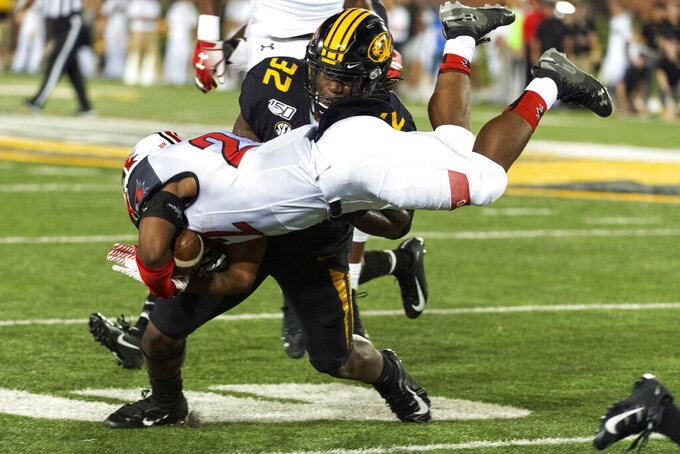 Southeast Missouri State running back Zion Custis, center, is tackled by Missouri linebacker Nick Bolton, top, during the second quarter of an NCAA college football game Saturday, Sept. 14, 2019, in Columbia, Mo. (AP Photo/L.G. Patterson)