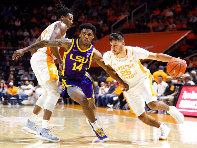 Tennessee guard Santiago Vescovi (25) drives past LSU guard Marlon Taylor (14)during an NCAA college basketball game at Thompson-Boling Arena, Saturday, Jan. 4, 2020,  Knoxville, Tenn. (Brianna Paciorka//Knoxville News Sentinel via AP)