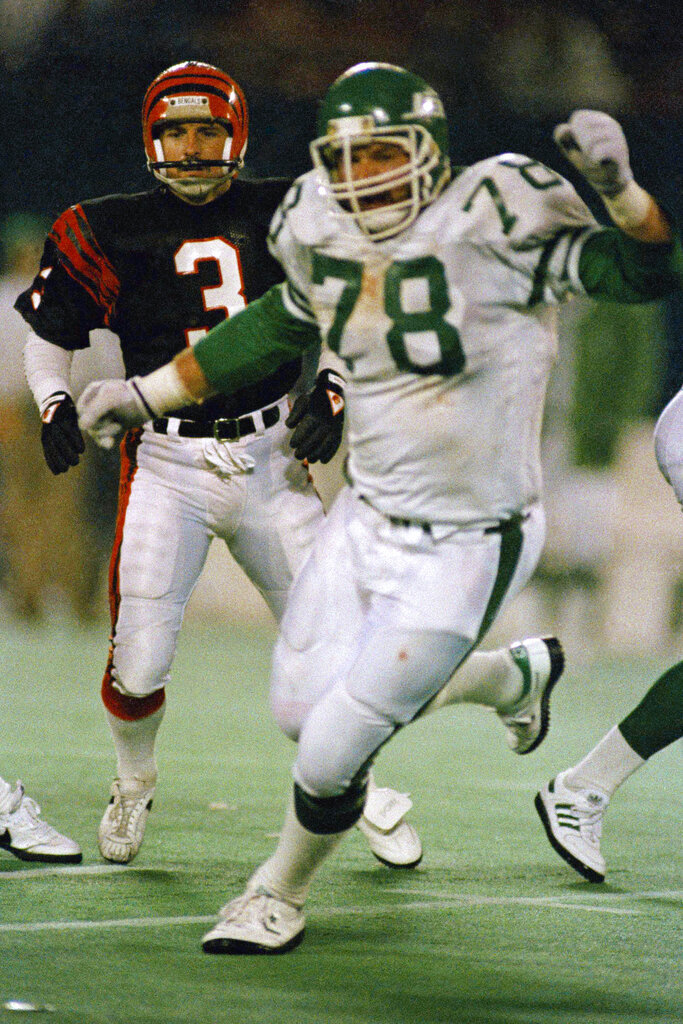 FILE - In this Nov. 30, 1987, file photo, Cincinnati Bengals place kicker Jim Breech (3) and New York Jets' Barry Bennett (78) react after Bennett blocked his game winning field goal attempt as they watch Jets' Rich Miano pick up the ball and run 67 yards for the winning touchdown in the fourth quarter of an NFL football game at Giants Stadium in East Rutherford, N.J. Authorities in Minnesota are investigating the deaths of a former NFL lineman and his wife and say the couple's son is a suspect. The bodies of 63-year-old Barry Bennett and his wife, Carol, were found Wednesday, Aug. 21, 2019, after a friend went to their home in Long Prairie for a welfare check. (AP Photo/Wilbur Funches, File)
