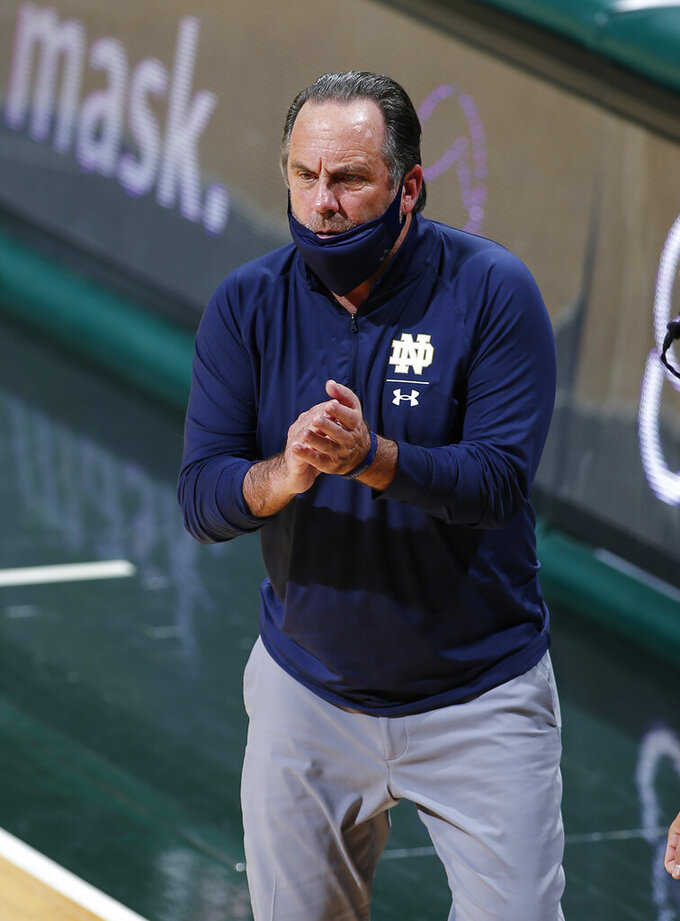 Notre Dame coach Mike Brey encourages his team during the second half of an NCAA college basketball game against Michigan State, Saturday, Nov. 28, 2020, in East Lansing, Mich. Michigan State won 80-70. (AP Photo/Al Goldis)