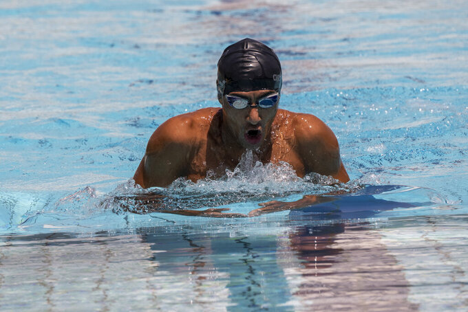 Syrian refugee Ibrahim al-Hussein, an amputee swimmer who lost his leg during the war in Syria, swims during a training at the Olympic Aquatic Centre, in Athens, on Wednesday , June 30, 2021. Ibrahim al-Hussein will be part of a Refugee Paralympic Team for the Tokyo 2020 Paralympic Games as the International Paralympic Committee announce Wednesday. (AP Photo/Petros Giannakouris)