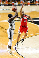 Vanderbilt's Maxwell Evans, left, shoots against Mississippi's Robert Allen (21) in the first half of an NCAA college basketball game Saturday, Feb. 27, 2021, in Nashville, Tenn. (AP Photo/Mark Humphrey)