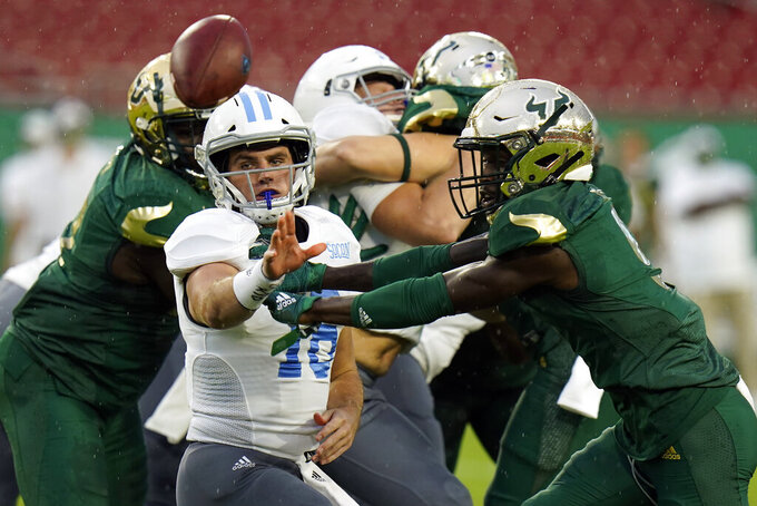 Citadel quarterback Brandon Rainey (16) pitches the ball as he is pressured by South Florida defensive back KJ Sails during the first half of an NCAA college football game Saturday, Sept. 12, 2020, in Tampa, Fla. (AP Photo/Chris O'Meara)