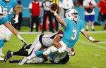 Miami Dolphins quarterback Josh Rosen (3) is tackled by Atlanta Falcons defensive tackle Jacob Tuioti-Mariner during the first half of a preseason NFL football game Thursday, Aug. 8, 2019, in Miami Gardens, Fla. (AP Photo/Wilfredo Lee)