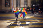 """FILE - In this Saturday, Sept. 4, 2021 file photo, people take part in the Zurich Pride parade in Zurich, Switzerland, with the slogan """"Dare. Marriage for all, now!"""" (Trau Dich. Ehe fuer alle. Jetzt!) for the rights of the LGBTIQ community. Swiss voters will wrap up a referendum on Sunday Sept. 26, 2021, to decide whether to allow same-sex marriage in the rich Alpine country, with supporters hoping for a big step toward ending discrimination against gays and lesbians while opponents fear what they consider an erosion of traditional family values. (Michael Buholzer/Keystone via AP, File)"""