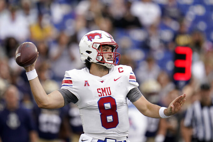 SMU quarterback Tanner Mordecai throws a pass against Navy during the first half of an NCAA college football game, Saturday, Oct. 9, 2021, in Annapolis, Md. (AP Photo/Julio Cortez)