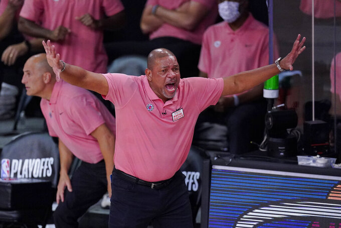 Los Angeles Clippers head coach Doc Rivers during the first half of an NBA conference semifinal playoff basketball game against the Denver Nuggets,Tuesday, Sept. 15, 2020, in Lake Buena Vista, Fla. (AP Photo/Mark J. Terrill)