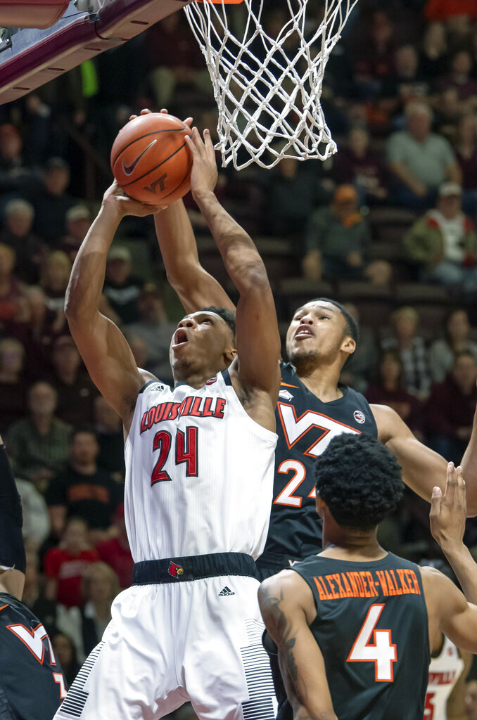 Louisville forward Dwayne Sutton (24) goes up for. Basket against Virginia Tech Hokies forward Kerry Blackshear Jr. (24) during the first half of an NCAA college basketball game Monday, Feb. 4, 2019, in Blacksburg, Va. (AP Photo/Don Petersen)