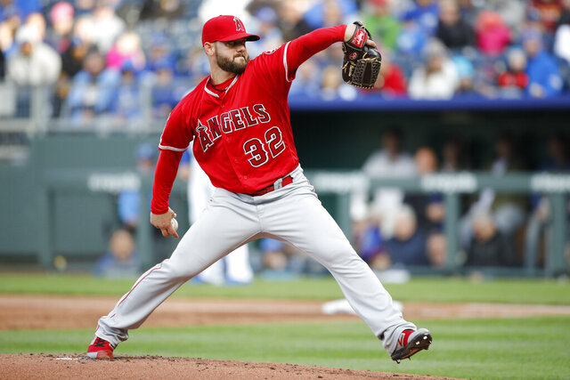 FILE - In this April 27, 2019, file photo, Los Angeles Angels pitcher Cam Bedrosian throws during the first inning of the team's baseball game against the Kansas City Royals at Kauffman Stadium in Kansas City, Mo. Bedrosian agreed to a $2.8 million, one-year contract with the Angels on Thursday, Jan. 9, 2020, that avoided arbitration. Bedrosian, a 28-year-old right-hander, completed his sixth season in the Angels' bullpen last year with a 3.23 ERA in 59 appearances, including seven short starts. His 1.14 WHIP was his best since 2016, but he converted just one of his four save opportunities. He made $1.75 million. (AP Photo/Colin E. Braley, File)