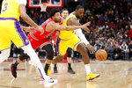 Los Angeles Lakers' LeBron James, right, and Chicago Bulls' Otto Porter Jr. battle for a loose ball during the first half of an NBA basketball game Tuesday, Nov. 5, 2019, in Chicago. (AP Photo/Charles Rex Arbogast)