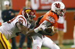Utah quarterback Tyler Huntley (1) eludes the tackle from Southern California defensive lineman Christian Rector (89) during the first half of an NCAA college football game Saturday, Oct. 20, 2018, in Salt Lake City. (AP Photo/Rick Bowmer)