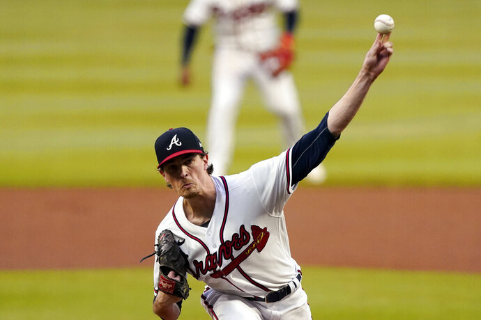 Atlanta Braves starting pitcher Max Fried works against the Miami Marlins in the first inning of a baseball game Wednesday, Sept. 23, 2020, in Atlanta. (AP Photo/John Bazemore)