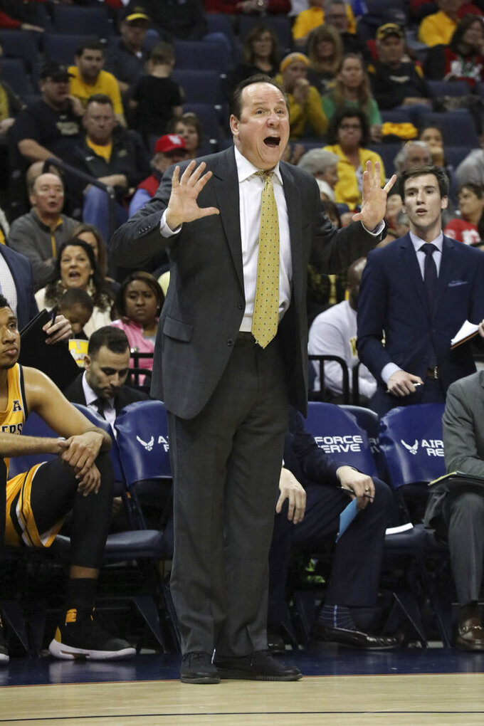 Wichita State Head Coach Gregg Marshall calls out to his team in the first half of an NCAA college basketball game at the American Athletic Conference tournament Saturday, March 16, 2019, in Memphis, Tenn. (AP Photo/Troy Glasgow)
