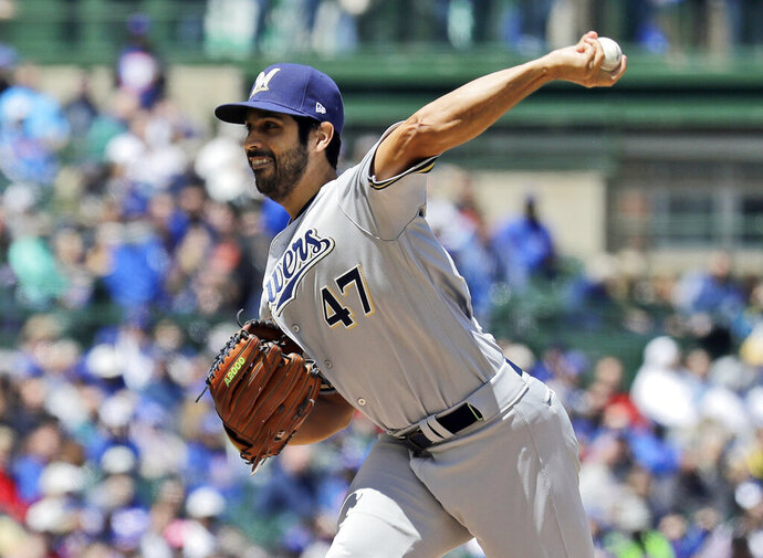 Milwaukee Brewers starting pitcher Gio Gonzalez throws against the Chicago Cubs during the first inning of a baseball game Friday, May 10, 2019, in Chicago. (AP Photo/Nam Y. Huh)