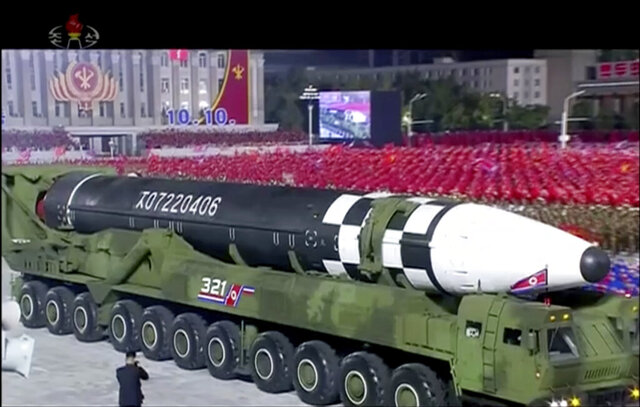 "This image made from video broadcasted by North Korea's KRT, shows a military parade with what appears to be possible new intercontinental ballistic missile at the Kim Il Sung Square in Pyongyang, Saturday, Oct. 10, 2020. North Korean leader Kim Jong Un warned Saturday that his country would ""fully mobilize"" its nuclear force if threatened as he took center stage at a massive military parade to mark the 75th anniversary of the country's ruling party. (KRT via AP)"