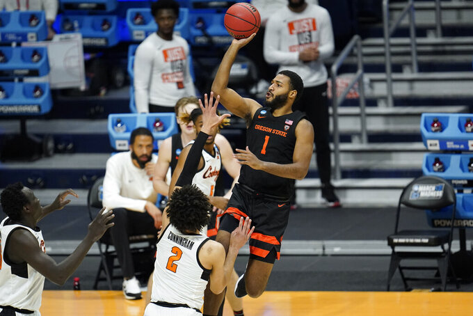 Oregon State forward Maurice Calloo (1) shoots over Oklahoma State guard Cade Cunningham (2) during the first half of a men's college basketball game in the second round of the NCAA tournament at Hinkle Fieldhouse in Indianapolis, Sunday, March 21, 2021. (AP Photo/Paul Sancya)