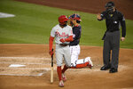 Philadelphia Phillies' Roman Quinn, left, reacts after he struck out during the third inning of a baseball game against the Washington Nationals, Monday, Sept. 21, 2020, in Washington. Quinn was ejected for arguing by home plate umpire Junior Valentine, right. (AP Photo/Nick Wass)