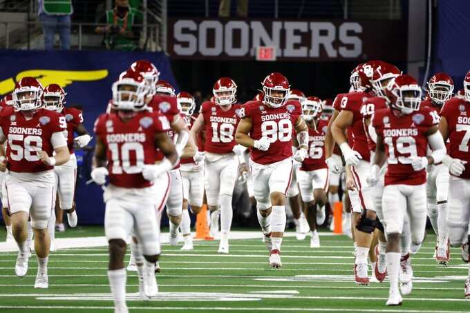 Oklahoma players run onto field for the team's Cotton Bowl NCAA college football game against Florida in Arlington, Texas, Wednesday, Dec. 30, 2020. (AP Photo/Ron Jenkins)