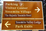 FILE - This March 1, 2016, file photo shows a traffic sign with changes to reflect new names for The Ahwahnee Hotel and Yosemite Lodge at the Falls in Yosemite National Park, Calif. On Monday, July 15, 2019, Delaware North, a company that lost its contract to run Yosemite National Park's hotels, restaurants and outdoor activities, has settled a lawsuit with the National Park Service and the park's new concession operator over rights to the names of famous park landmarks. (Rory Appleton/The Fresno Bee via AP, File)