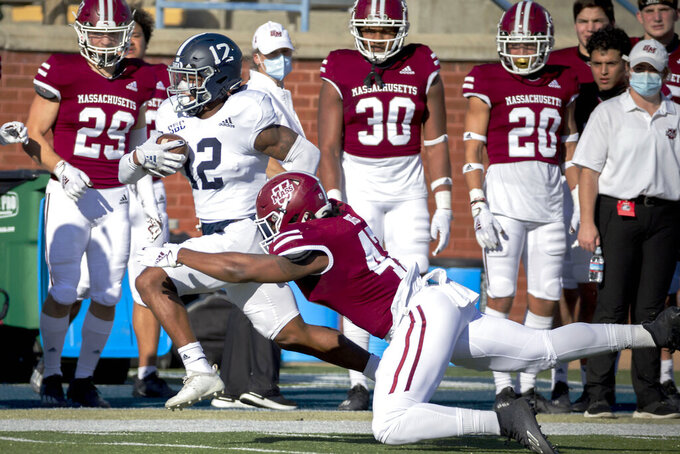 Georgia Southern running back Wesley Kennedy III (12) is tackled by Massachusetts linebacker Da'Shon Ross (47) during the first half of an NCAA football game, Saturday, Oct. 17, 2020, in Statesboro, Ga. (AP Photo/Stephen B. Morton)