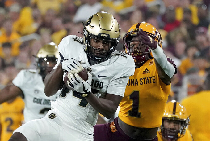 Colorado State wide receiver Dimitri Stanley (14) hauls in a pass against Arizona State defensive back Jordan Clark (1) during the first half of an NCAA college football game  Saturday, Sept 25, 2021, in Tempe, Ariz. (AP Photo/Darryl Webb)