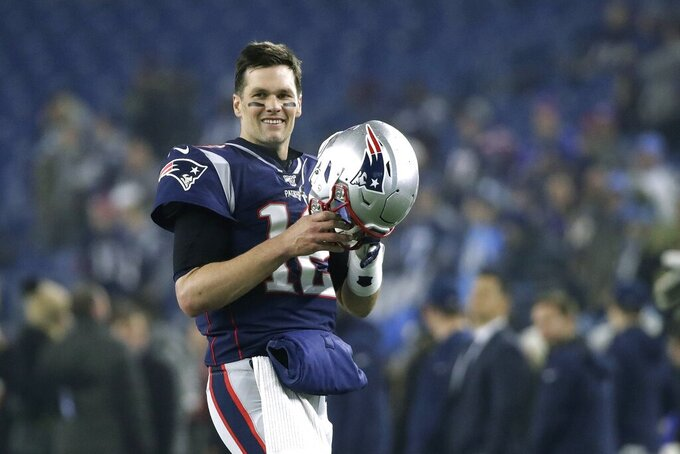 New England Patriots quarterback Tom Brady warms up before an NFL wild-card playoff football game against the Tennessee Titans, Saturday, Jan. 4, 2020, in Foxborough, Mass. (AP Photo/Elise Amendola)