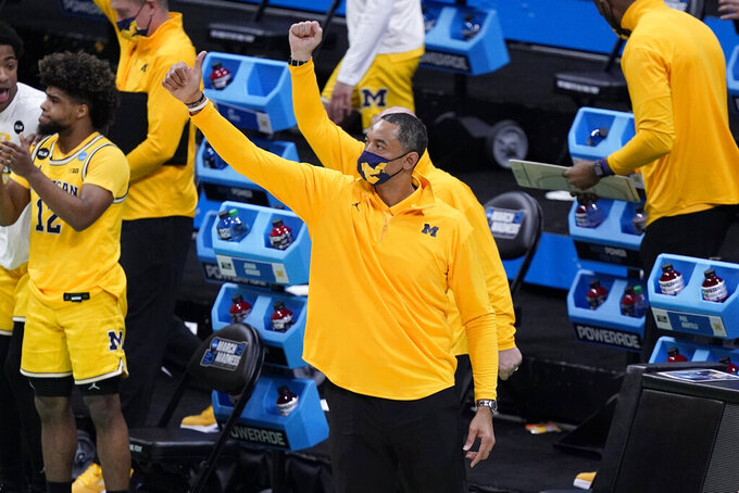 Michigan head coach Juwan Howard celebrates at the end of a second-round game against LSU in the NCAA men's college basketball tournament at Lucas Oil Stadium Monday, March 22, 2021, in Indianapolis. Michigan won 86-78. (AP Photo/Darron Cummings)