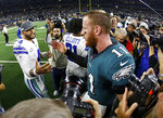 Dallas Cowboys quarterback Dak Prescott (4) and Philadelphia Eagles quarterback Carson Wentz (11) greet each other after their NFL football game in Arlington, Texas, Sunday, Oct. 20, 2019. (AP Photo/Ron Jenkins)