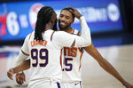 Phoenix Suns forward Jae Crowder, left, hugs forward Mikal Bridges as time runs out in the second half of Game 4 of an NBA second-round playoff series against the Denver Nuggets, Sunday, June 13, 2021, in Denver. Phoenix won 125-118 to sweep the series. (AP Photo/David Zalubowski)