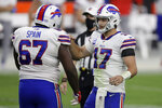 Buffalo Bills quarterback Josh Allen (17) celebrates with offensive guard Quinton Spain after defeating the Las Vegas Raiders in an NFL football game, Sunday, Oct. 4, 2020, in Las Vegas. The Bills won 30-23. (AP Photo/Isaac Brekken)